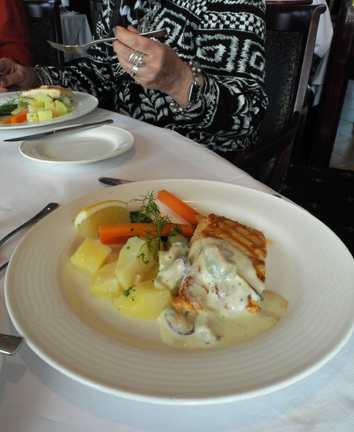 "Grilled Salmon ""A la Flamande Served with Fresh lemon, asparagus, parsley potato and creamy mussels."